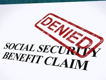14055029 - social security claim denied stamp showing social unemployment benefit refused